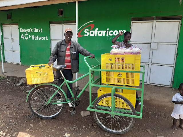 Kenyans with bicycle selling bread in Kenya.