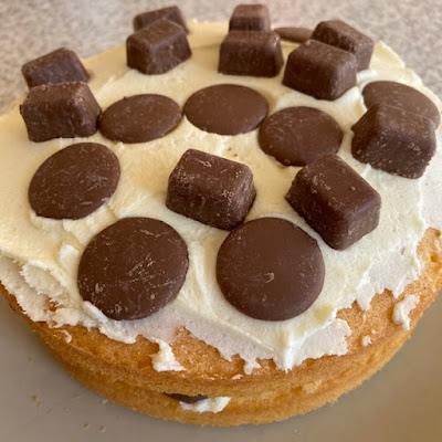 Victoria sponge cake with chocolate buttons on top