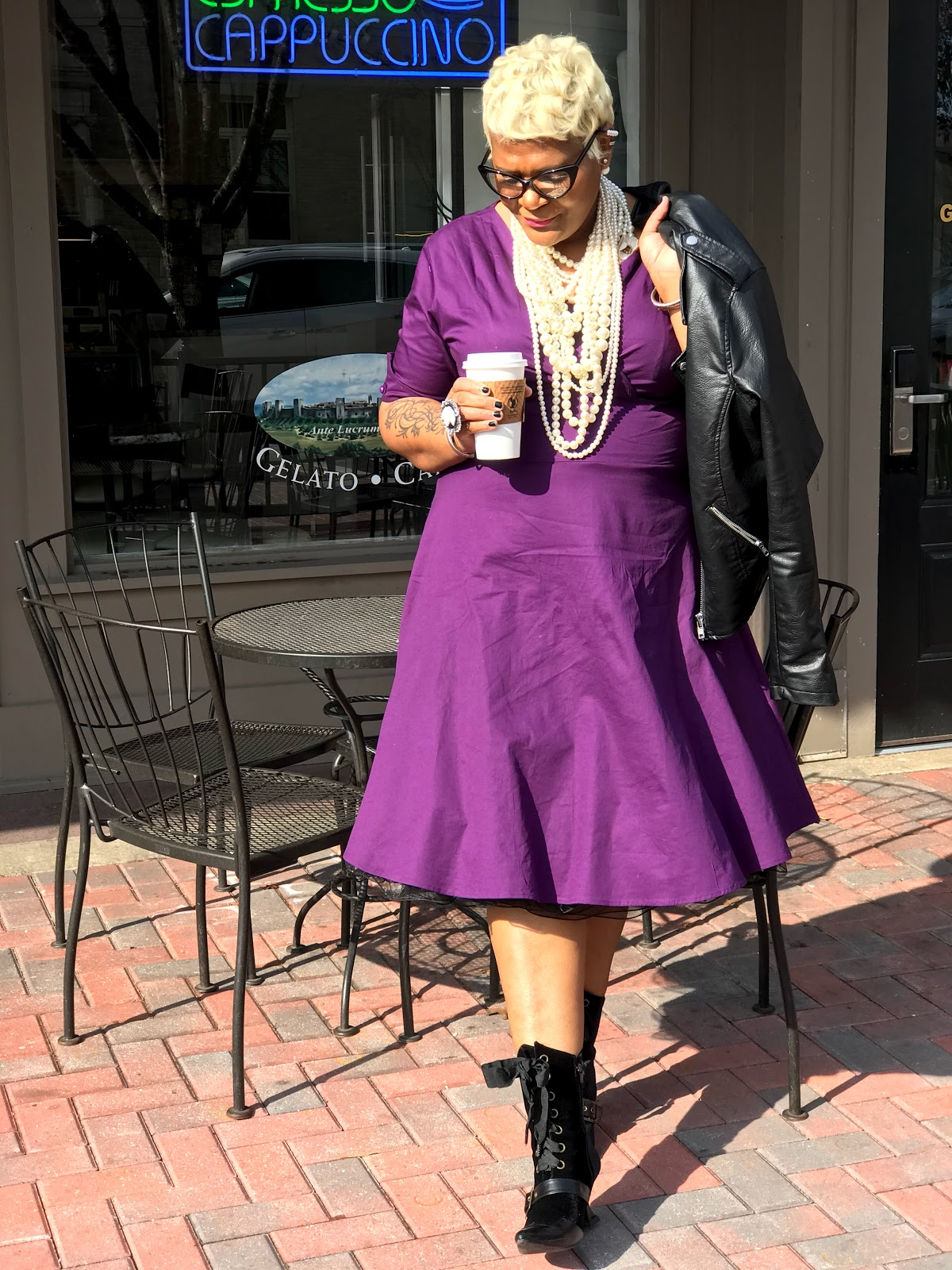 Judge My Style: Tangie Bell Wearing A Purple Dress from the thrift store for a wedding. She styled it with pearls, Leather Jacket and handbag with granny boots