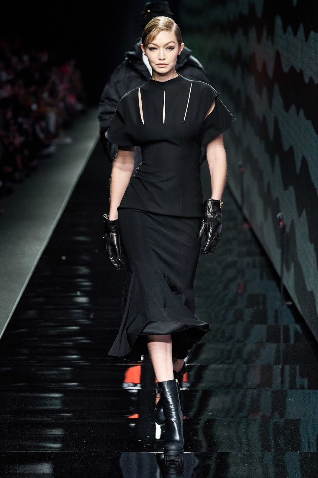 Gigi Hadid's Versace FW20 Milan Fashion Show look was an elegant and demure all-black one