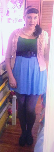 Light pink ruffle cardigan, dark green tank top and baby blue mini skirt pin up style outfit of the day