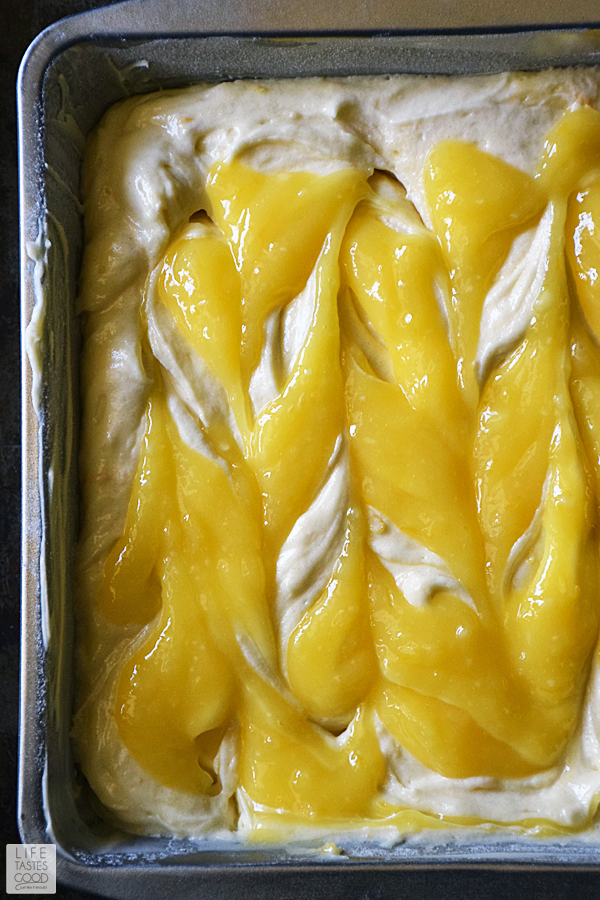 Swirls of homemade lemon curd in Lemon Crumb Cake batter