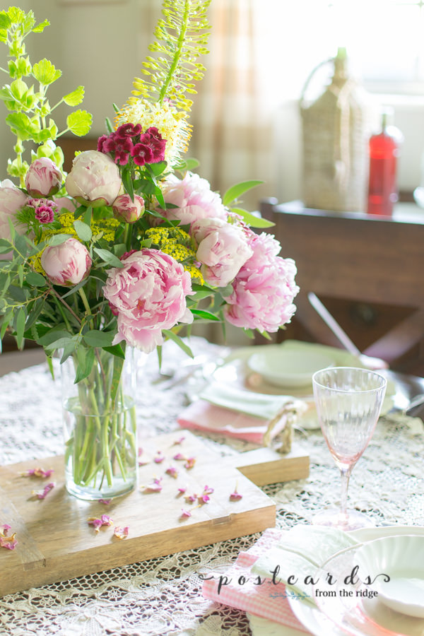 pink peony centerpiece with spring colors and vintage pink depression glass