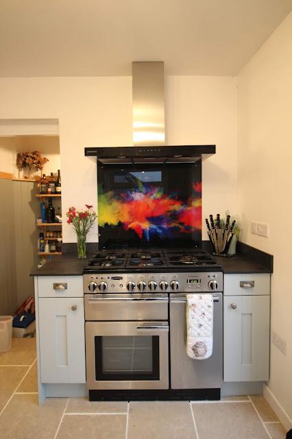 Light blue kitchen with dark worktops