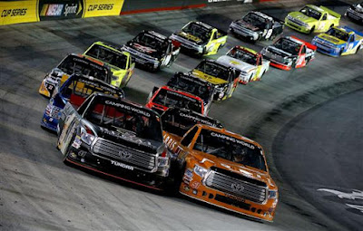 Daniel Suarez, driver of the #51 ARRIS Toyota, leads the field during a restart.