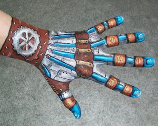 Steampunk special fx makeup robot body paint on hand. Gears and metal drawn on.
