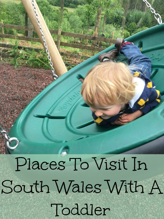 Places-to-visit-in-South-Wales-with-a-toddler-text-on-image-of-toddler-on-swing