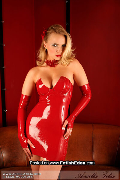 Blonde beauty Ancilla Tilia in red latex mini-dress and long red latex fingerless gloves