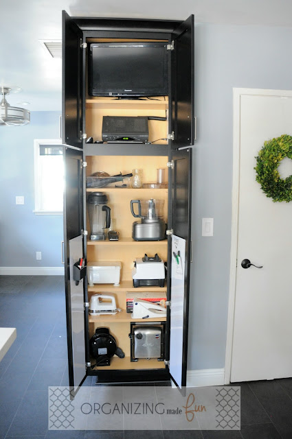 Utility Organizer Cabinet used for storing hidden TV and small appliances :: OrganizingMadeFun.com