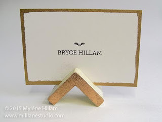 The triangular profile of the place card holder compliments the chevron table runners
