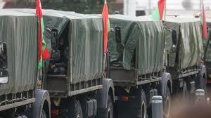 Military trucks deployed to block road before demonstrators in Minsk