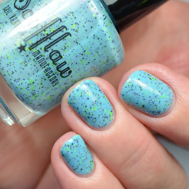 blue glitter nail polish swatch