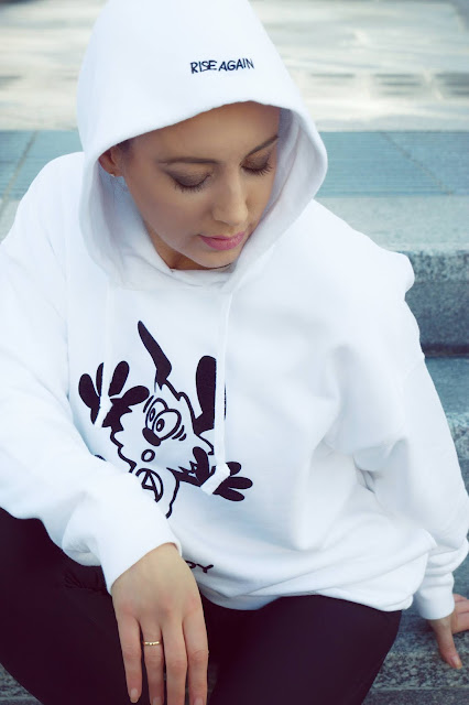 white sweatshirt with graphic on hood