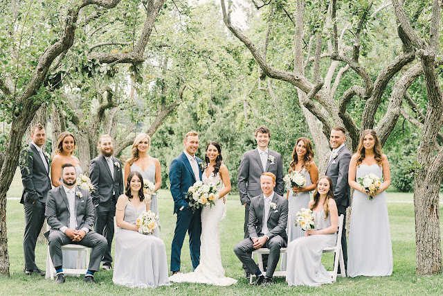 Niagara Wedding Planner | A Divine Affair | Sara and Daniel - Photo by Julia Park Photography. Ceremony and Reception at Kurtz Orchards Gracewood Estates. Ceremony under a chiffon and floral draped tree. Reception in a tent with live edge wooden harvest tables.