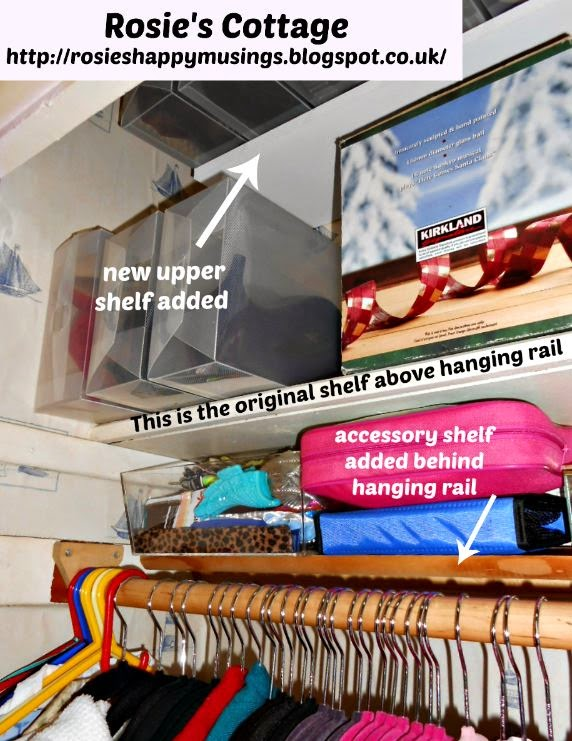 Two clever shelves (one directly behind the clothes rail) make use of every bit of space in the tiny closet.