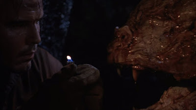 Graveyard Shift 1990 movie still where David Andrews encounters a gigantic mutant creature at his workplace