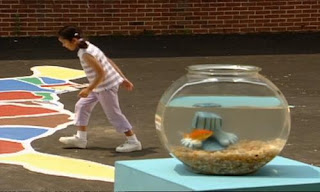 Kids hop on one foot in the park and play hop scotch. Sesame Street Elmo's World Feet Kids and Baby.