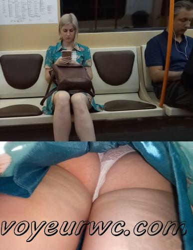 Upskirts 4299-4308 (Secretly taking an upskirt video of beautiful women on escalator)