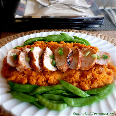 Maple Balsamic Chicken Breast, a simple and flavorful dinner. Chicken is marinated, baked or grilled, and served over a bed of mashed sweet potatoes | Recipe developed by www.BakingInATornado.com | #recipe #chicken #dinner