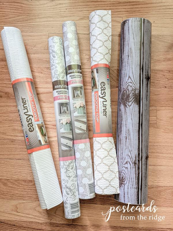 rolls of Duck Brand Easy Liner on wood floor