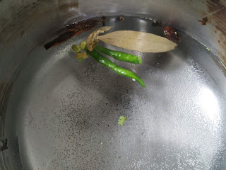 Chilli, Bay leaves, cinnamon stick, Cardamom in water for rice cooking for veg biryani recipe