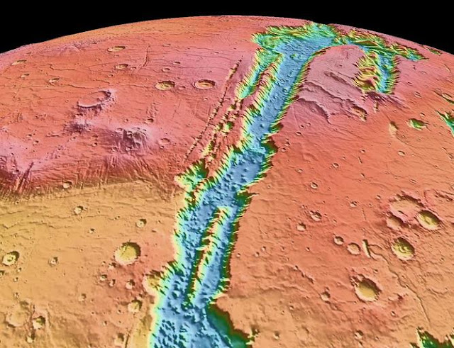A topographic view of Valles Marineris, one of the largest rift systems in the solar system. This image has been made from data collected by the Mars Orbiter Laser Altimeter (MOLA) instrument which is flying on the Mars Global Surveyor.  NASA