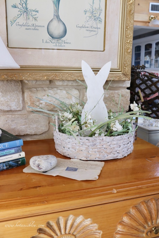 Usher in spring with white bunny arrangement on pine chest of drawers