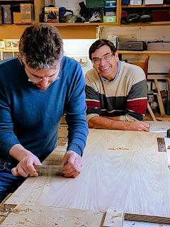 A student using a cabinet scraper