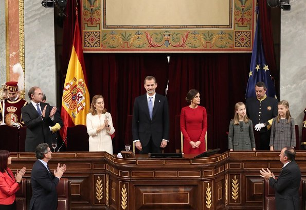 Queen Letizia wore Carolina Herrera red dress and clutch, Magrit pumps. Princess Leonor, Infanta Sofía and Queen Sofia