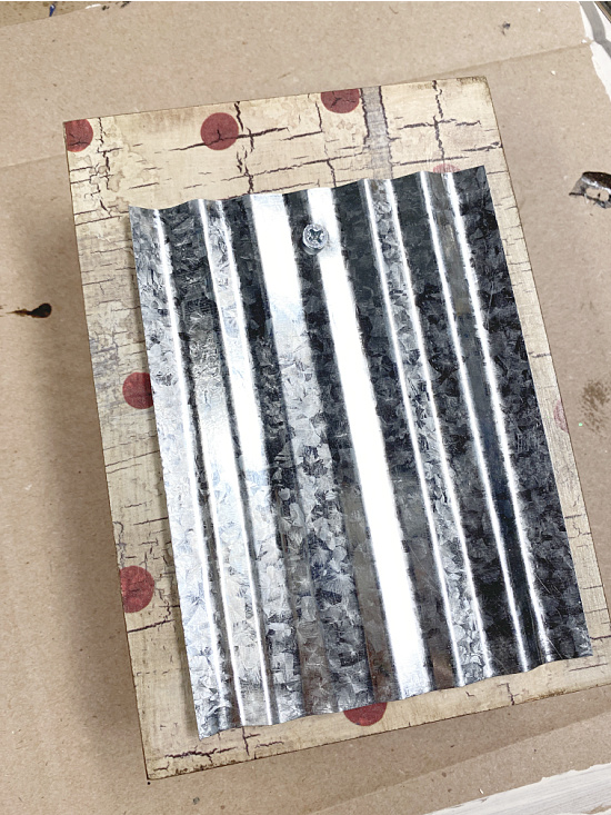 galvanized steel attached to box with a screw