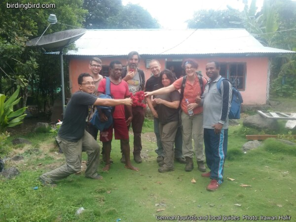 German visitors with local guides in Manokwari of Indonesia after watching King Bird of Paradise