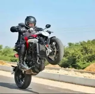 thala ajith bike stunt picture