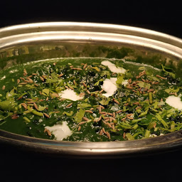 Serving Methi palak with fried cumin seeds and coriander leaves for methi palak recipe