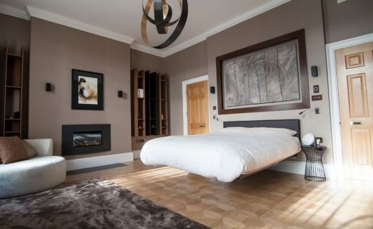 Floating bed in the modern bedroom in neutral tones