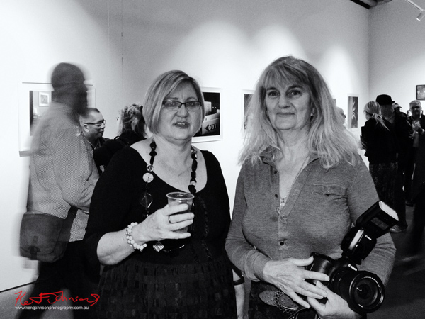 Suellen Symons (on right) and friend at Coterie Exhibition.  Photographed by Kent Johnson.