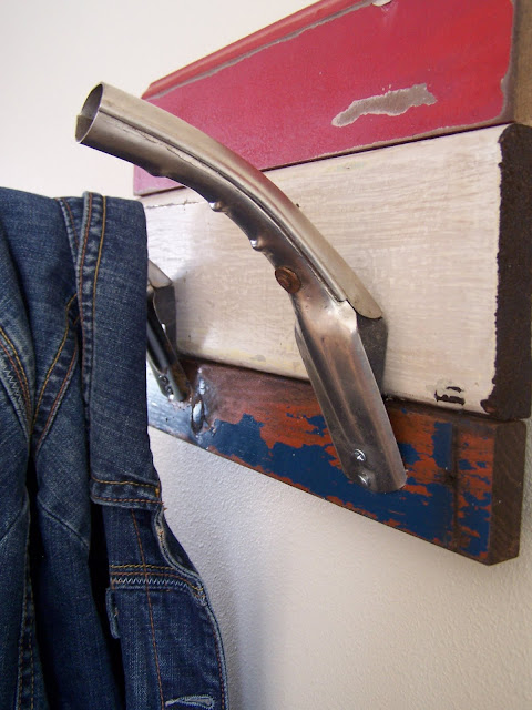 repurposed coat hook from oil can nozzles http://bec4-beyondthepicketfence.blogspot.com/2011/05/patriotic-coat-hook-its-gas.html