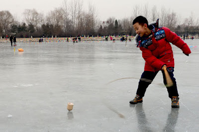 Spin Top on Ice