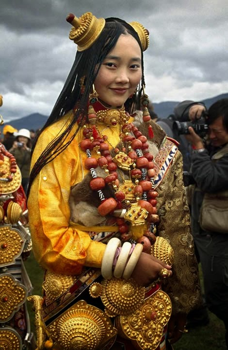 Portrait of a Yi woman wearing traditional clothes and headdress