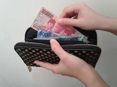 Dompet Wajib di bawa saat liburan