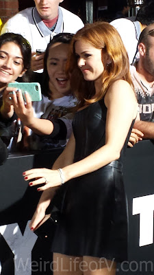 Isla Fisher taking a selfie with a fan