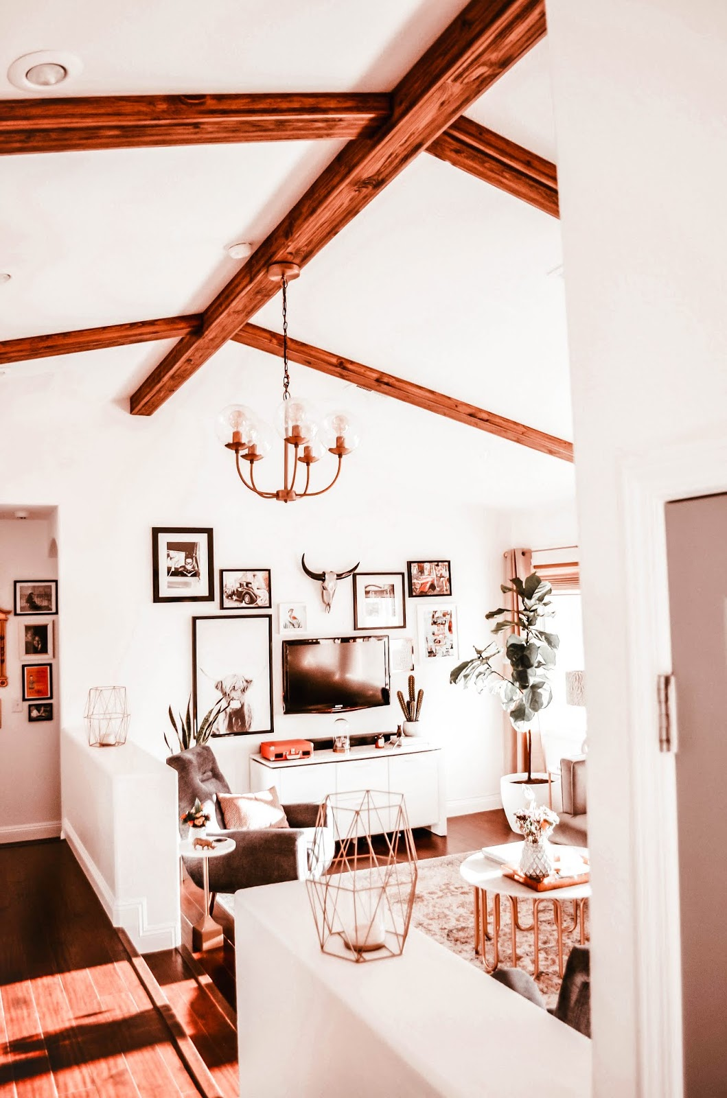 1980s-style-house-livingroom-renovation-update-with-reclaimed-wood-beams-to-cathedral-ceilings