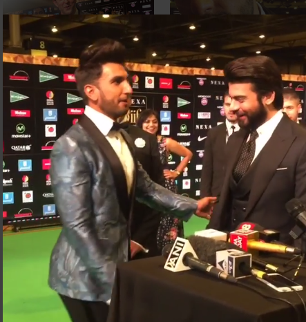 Pakistani heartthrob Fawad Khan makes girls swoon whenever they see him. At an IIFA event in Madrid, Ranveer Singh enacted how it really happens.  He was speaking to the press, when he saw Fawad Khan and Karan Johar walking in. The monkey and the actor in him took over.  In a brilliant piece of impromptu acting Ranveer Singh showed how girls react, when they see Fawad Khan -  screaming, choking on words, with hands on mouth  - Oh My God, Fawad is coming... As Fawad Khan enjoyed the joke and gave him a hug, Ranveer Singh asked innocently, why chicks went crazy, whenever they saw him.