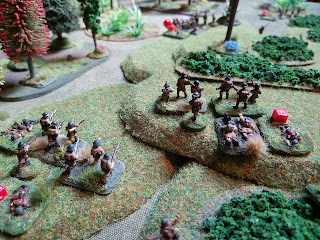 The Australians move forward to fire on the second Japanese section