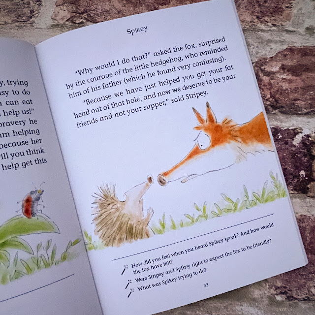 The open book showing a picture of the hedgehog meeting a fox