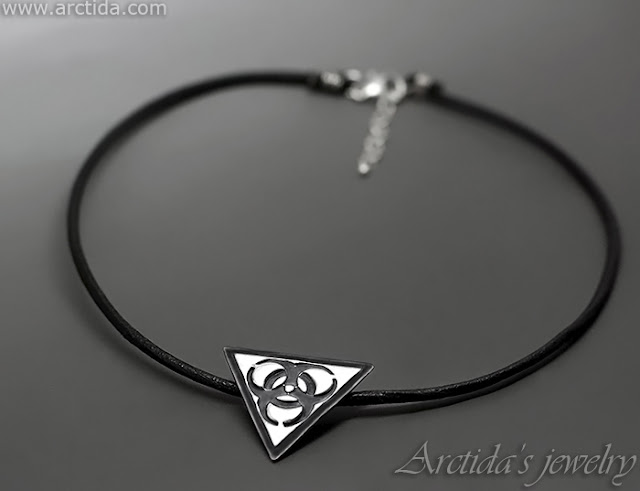 http://www.arctida.com/en/home/120-science-jewelry-biohazard-necklace-fine-silver-pendant-on-leather-cord.html