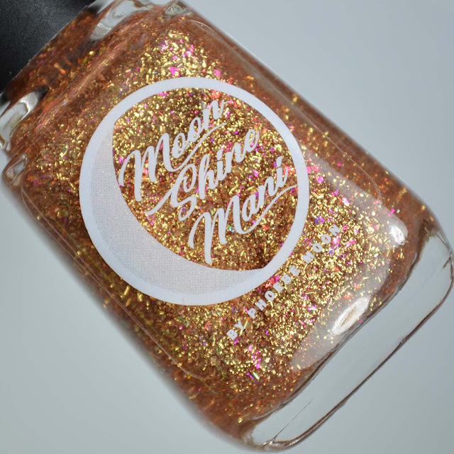 gold flakie nail polish topper in a bottle