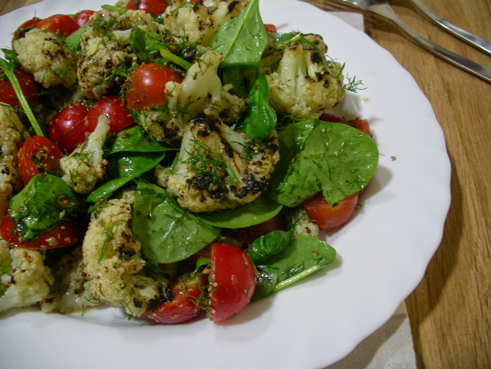 Grilled cauliflower with tomato, dill and capers