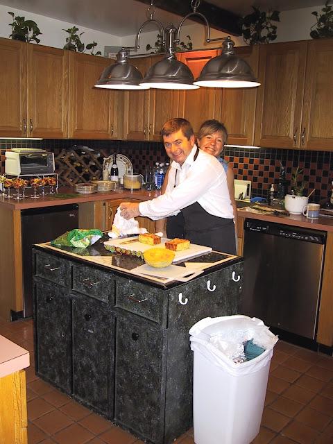smiling couple in kitchen preparing breakfast