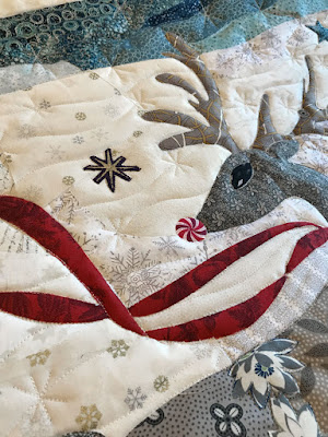 taupe applique reindeer on a cream background