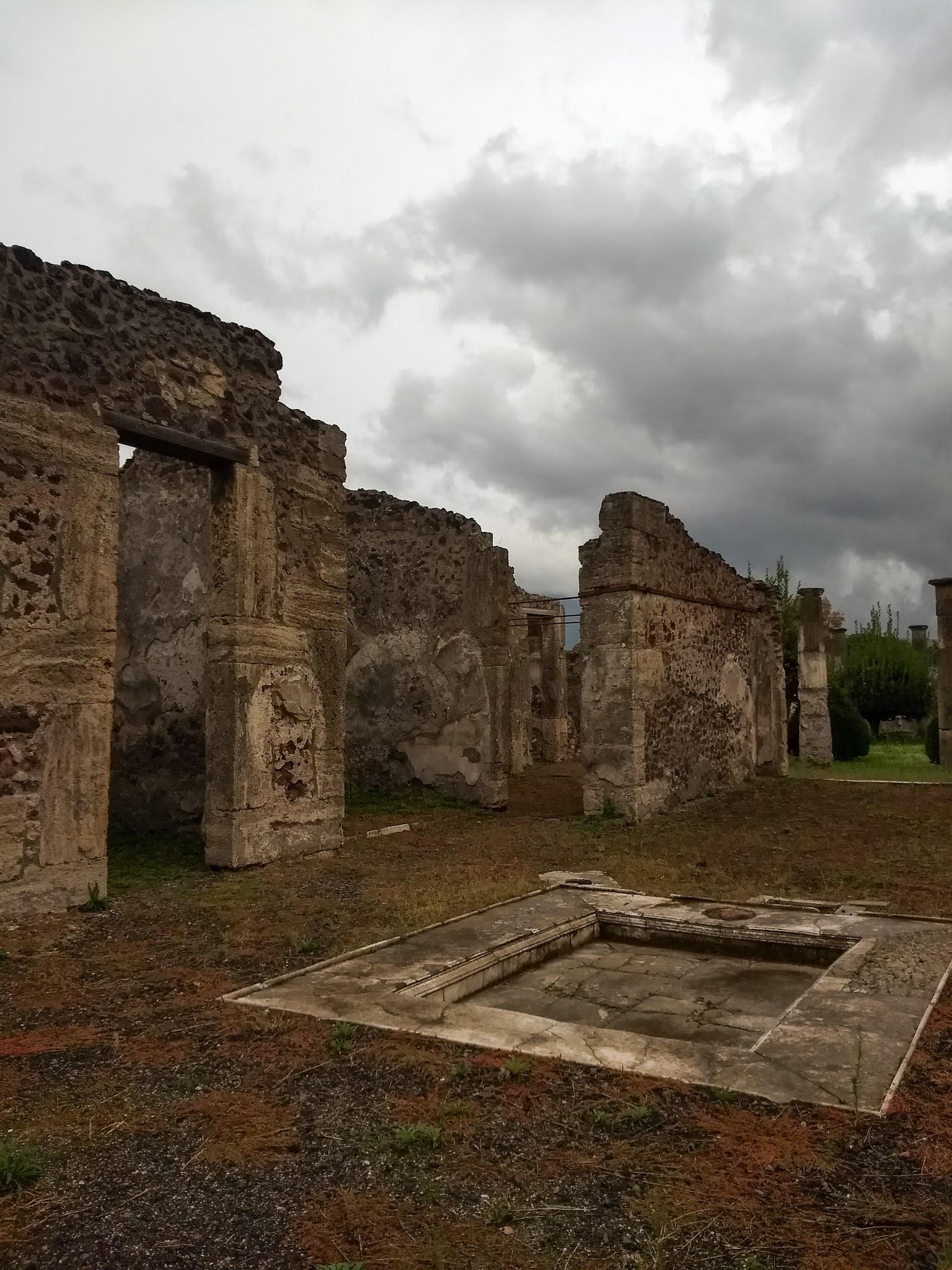 View of a pool in the atrium of Domus Cornelia, Pompeii, Italy.